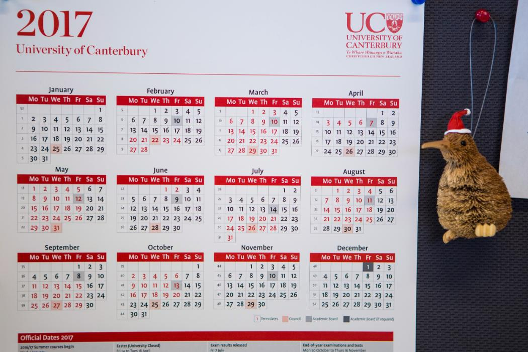 UC calendar on wall of office