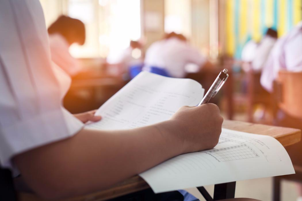 Student taking test in class room