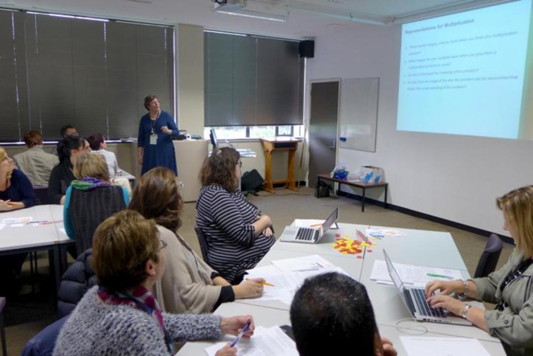 Facilitator leading workshop with group of teachers