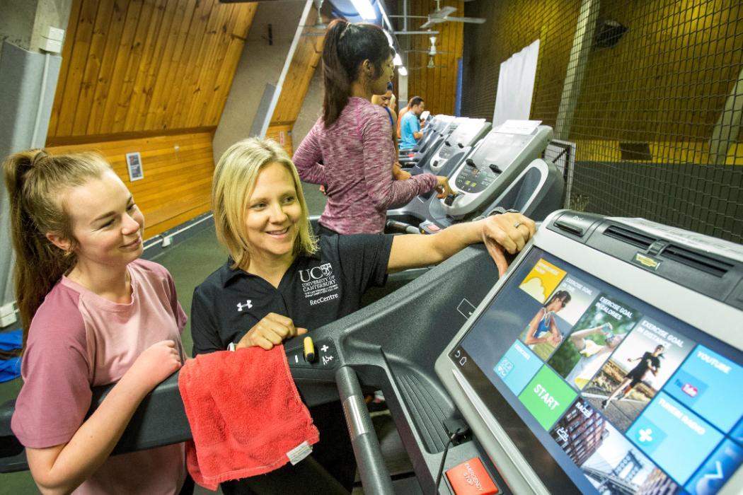 Fitness Consultant Showing Member treadmill