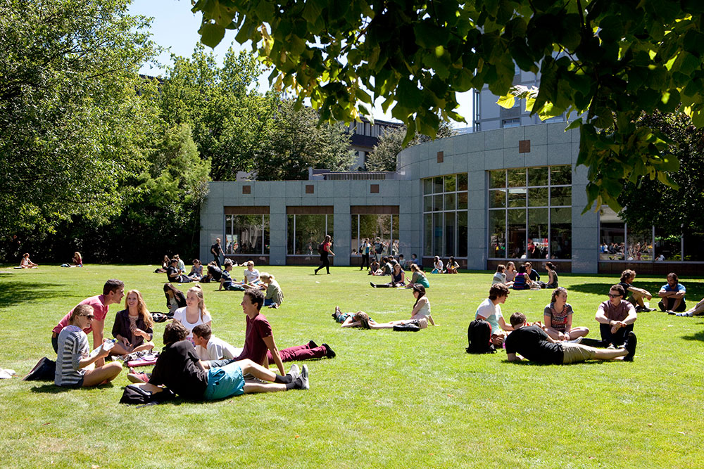 Students summer central lawn landscape