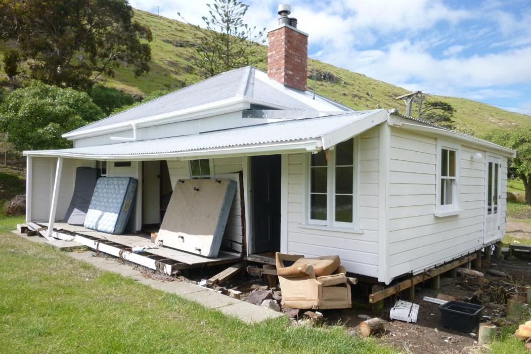 Quake damaged Little Pigeon Bay Cottage