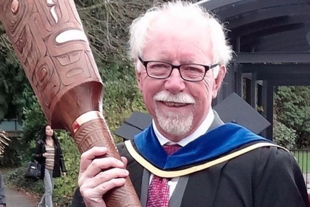 Graeme Wynn holding carving