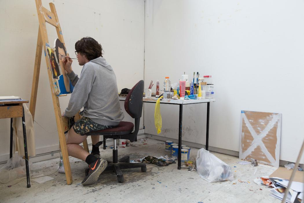 Arts student painting a portrait