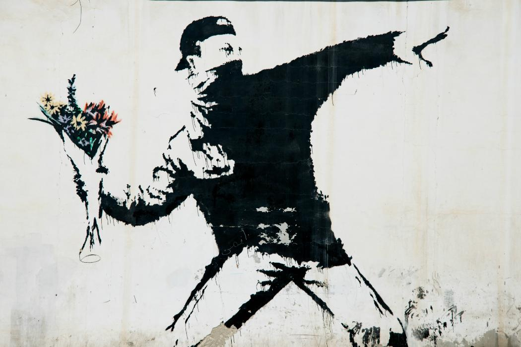 Banksy man throwing flowers