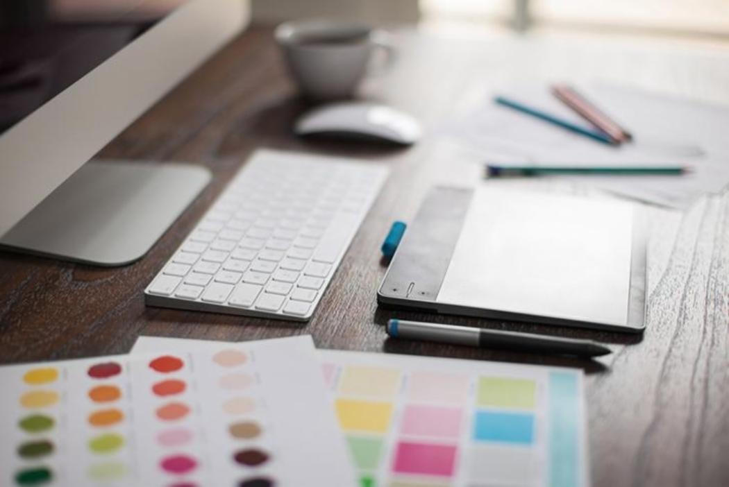Graphic design tablet, keyboard and colour swatches