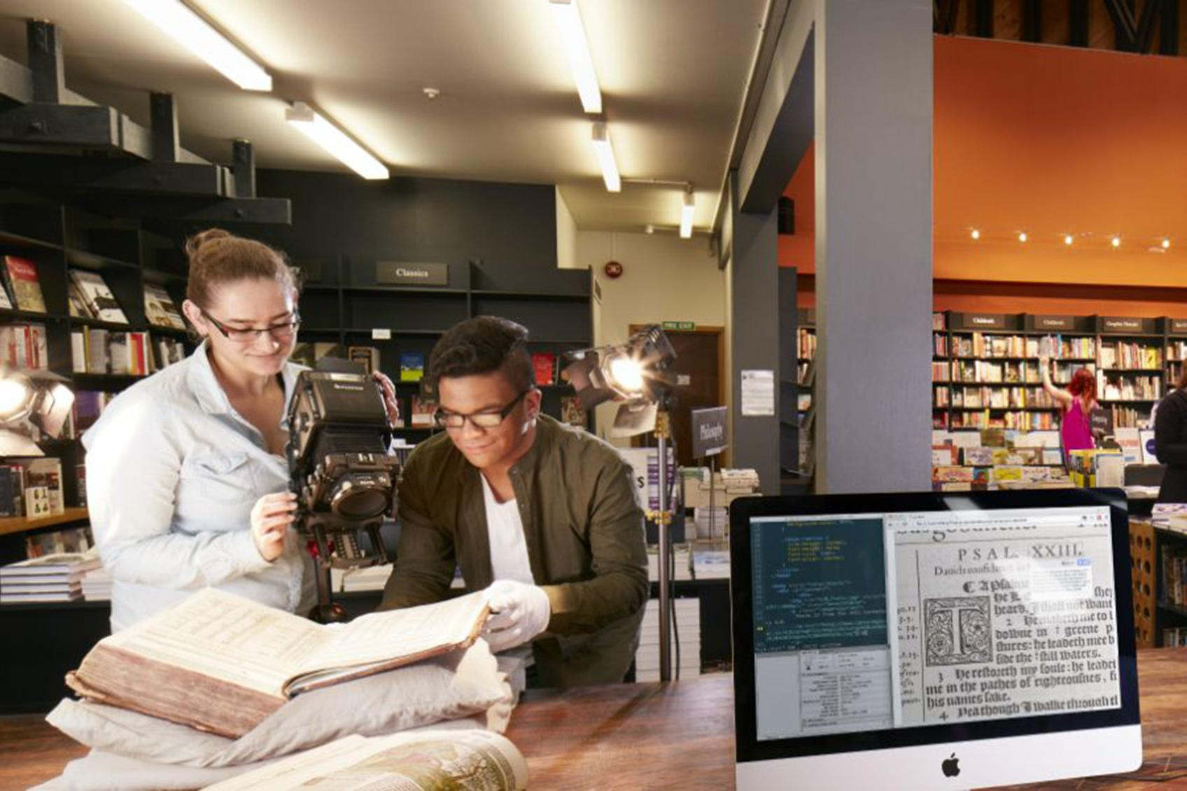 Students photographing an antique manuscript. Image supplied by Digital Arts dept