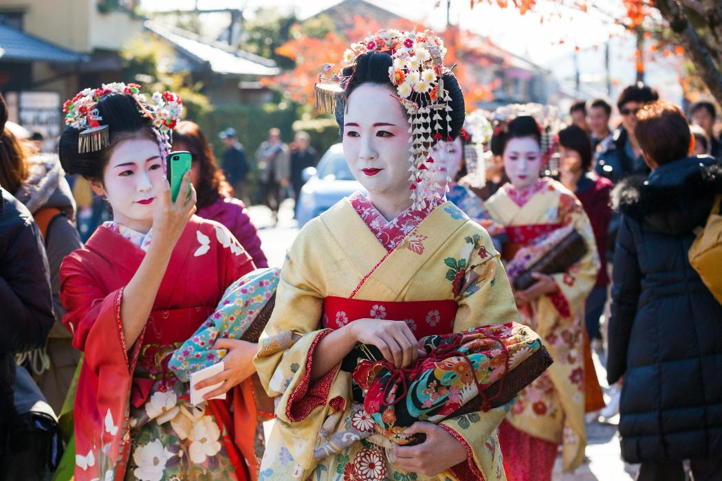 geishas on street in japan
