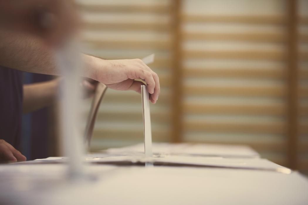 voting hand ballot box