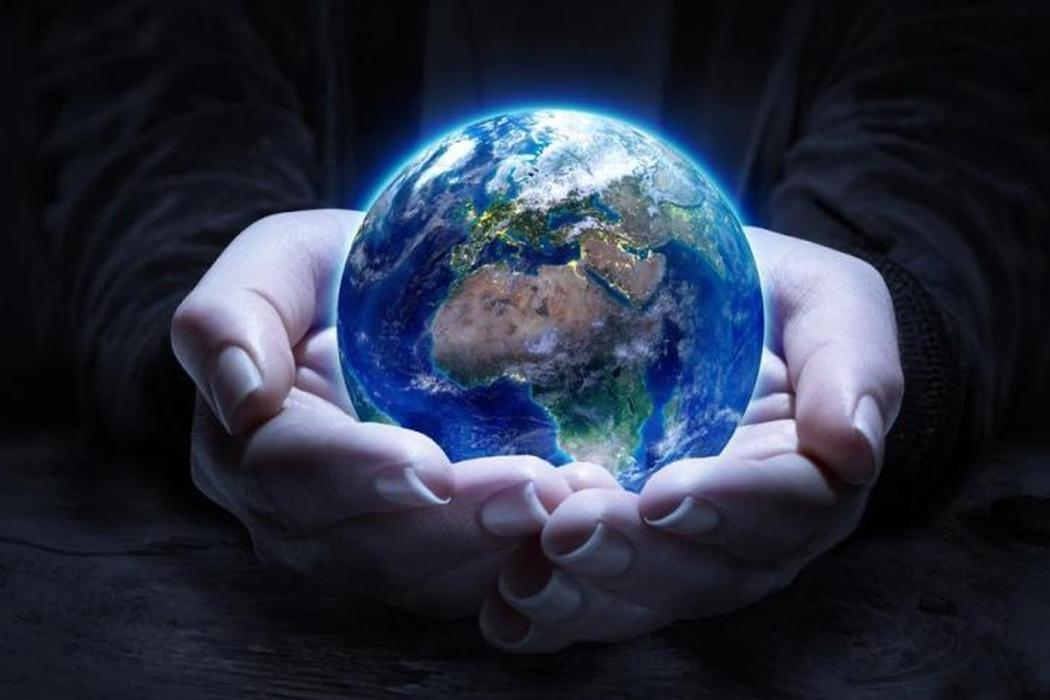 Hands holding world globe