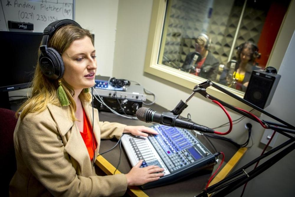 Media reporter in the radio studio