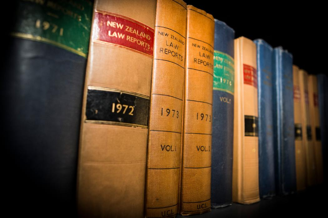 law reports lined up on a bookshelf