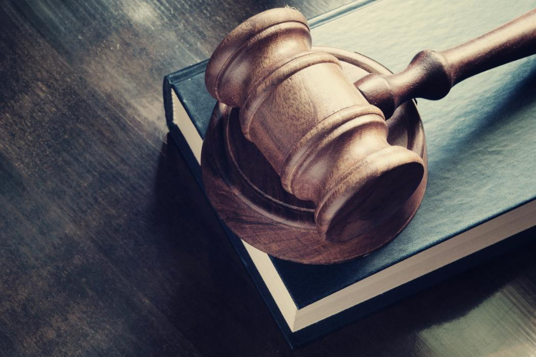 Gavel on top of a book on a desk