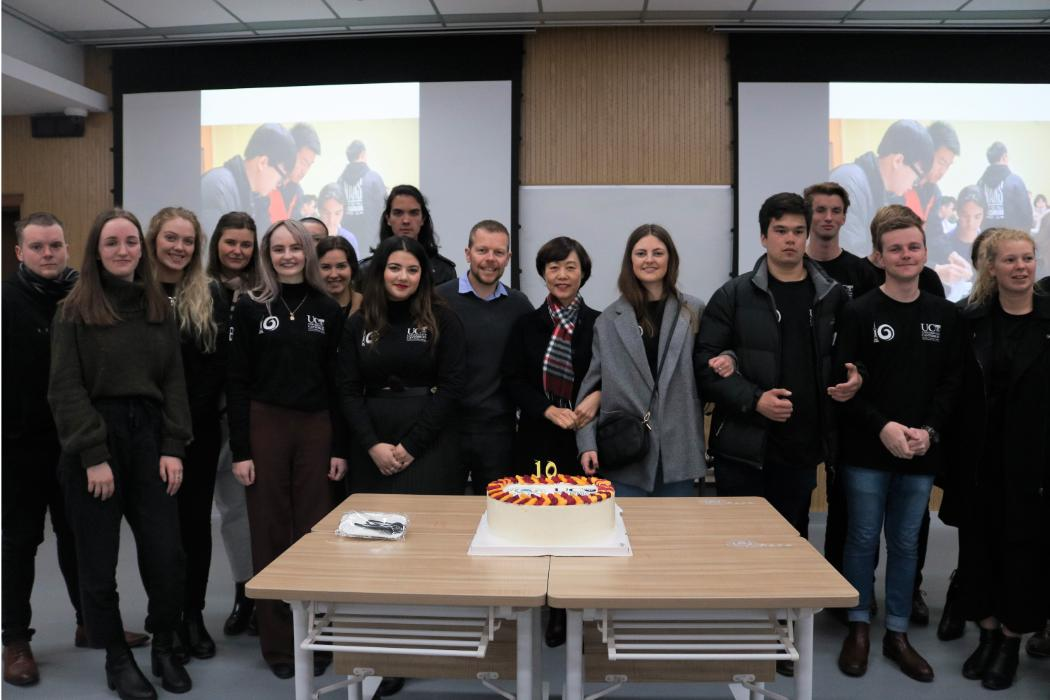 MGM 228 students with 10th birthday cake