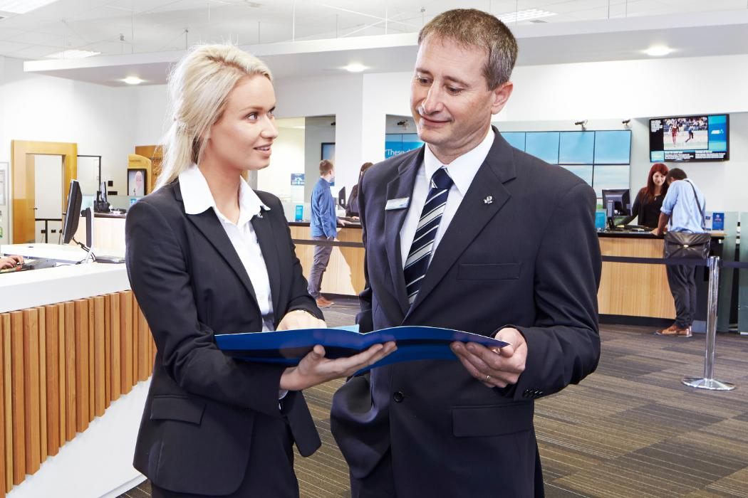 business students in suits on site in a bank