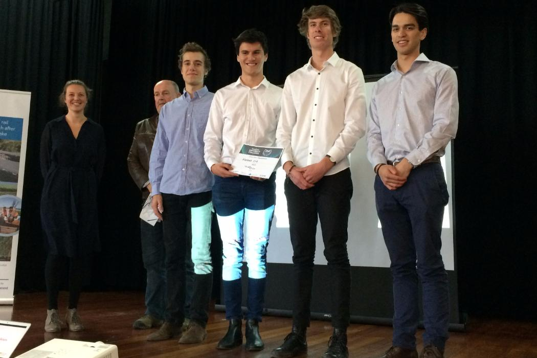 group with certificate on stage