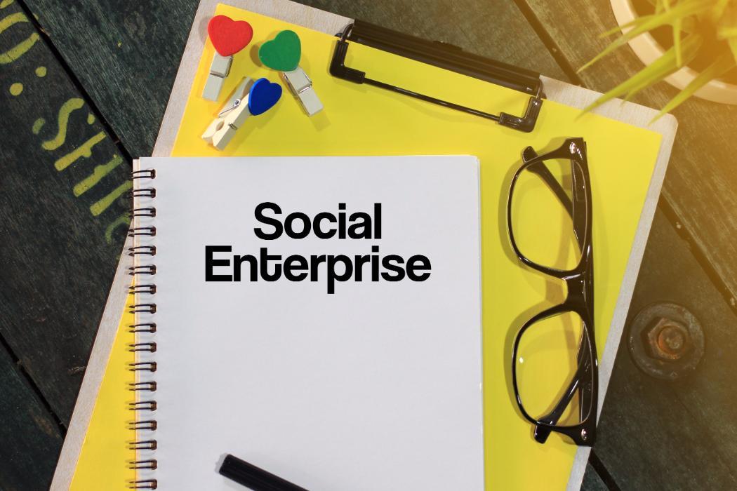 notebook with heading social enterprise