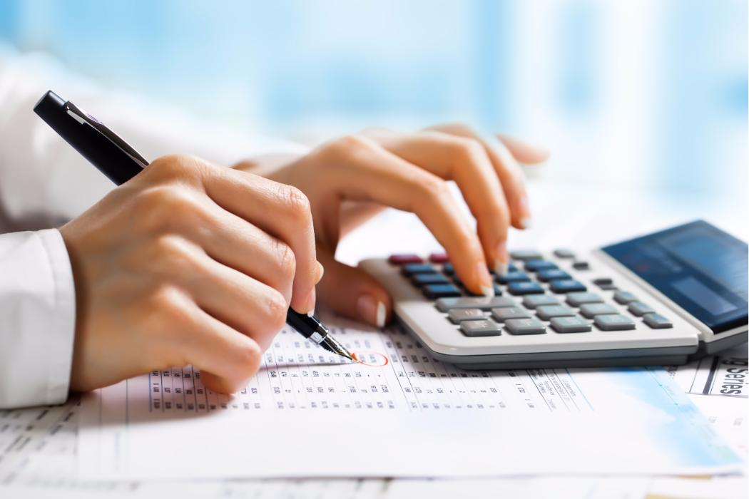 close up on calculator and accounting tables