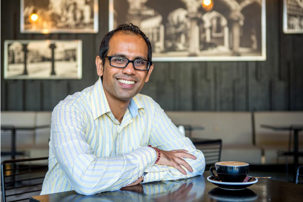 Girish Prayag photographed in the Shilling Club with coffee