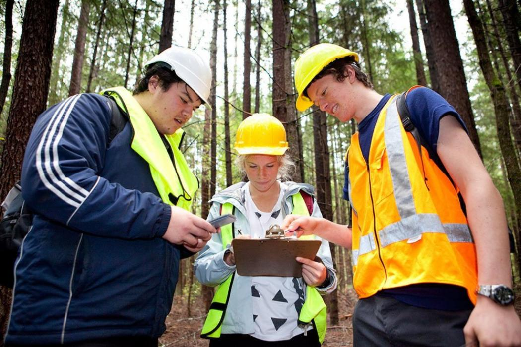 Three forestry students on a field trip