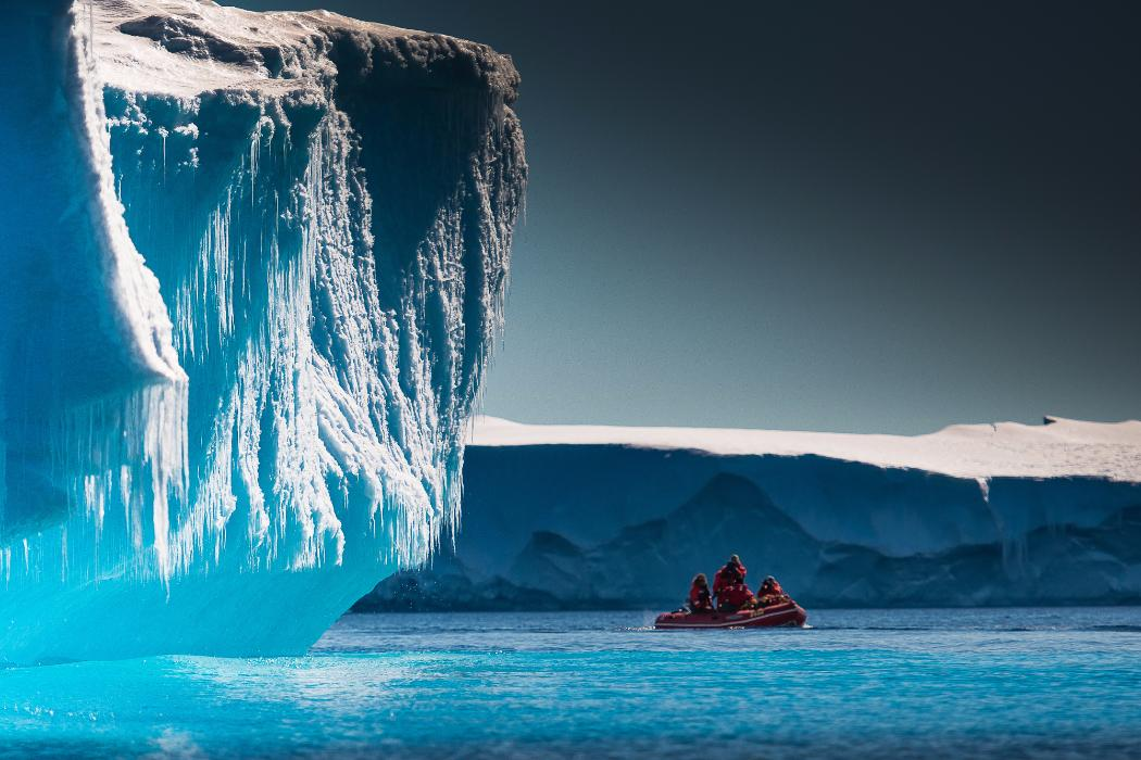 researchers view iceberg from boat