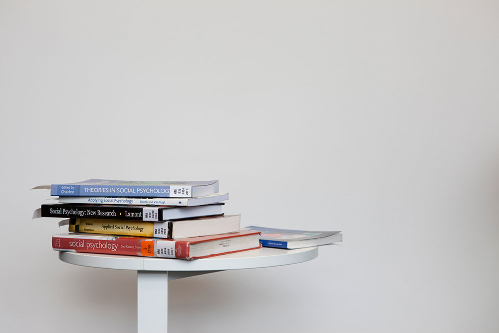 Stack of library books on white background landscape