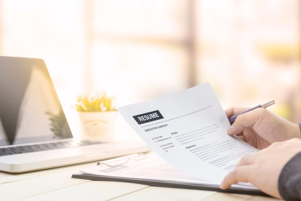 Man reading over resume