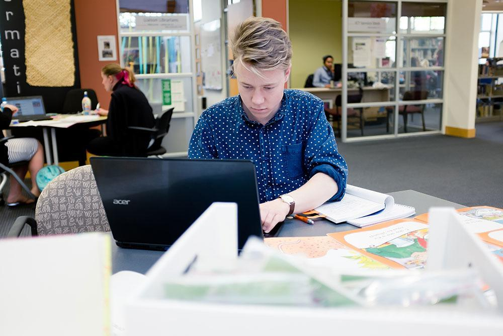 Bachelor of Teaching and Learning (Primary) student Isaac Rule in UC's Education library. © Restricted/University of Canterbury