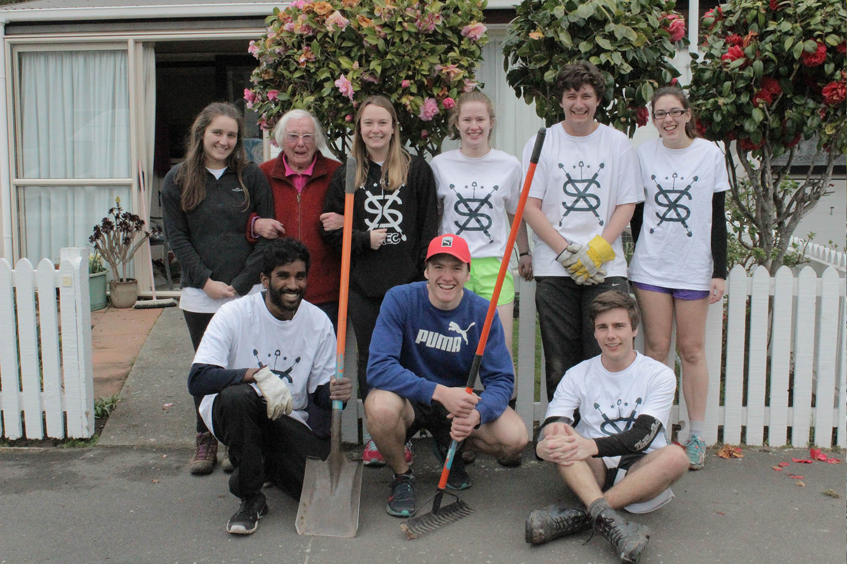 Student Volunteer Army clean up with elderly woman