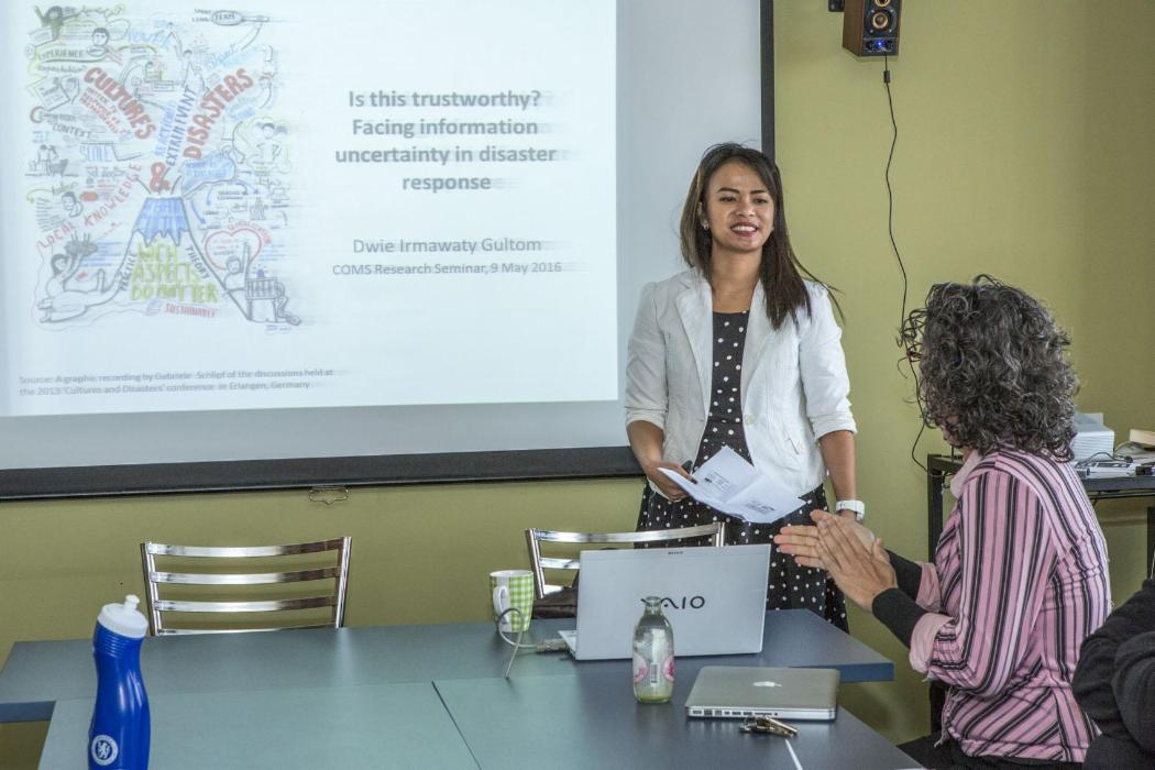 woman giving media and communications presentation