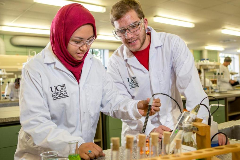 Male and female chemistry students at work