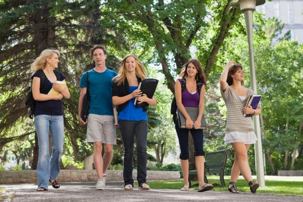 University students walking and talking together on campus