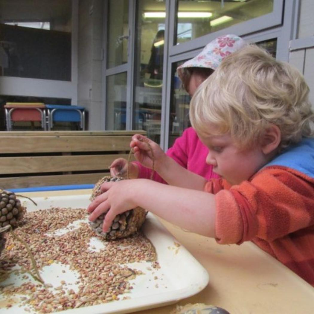 boy-playing-with-pinecone_EYC_gallery.jpg