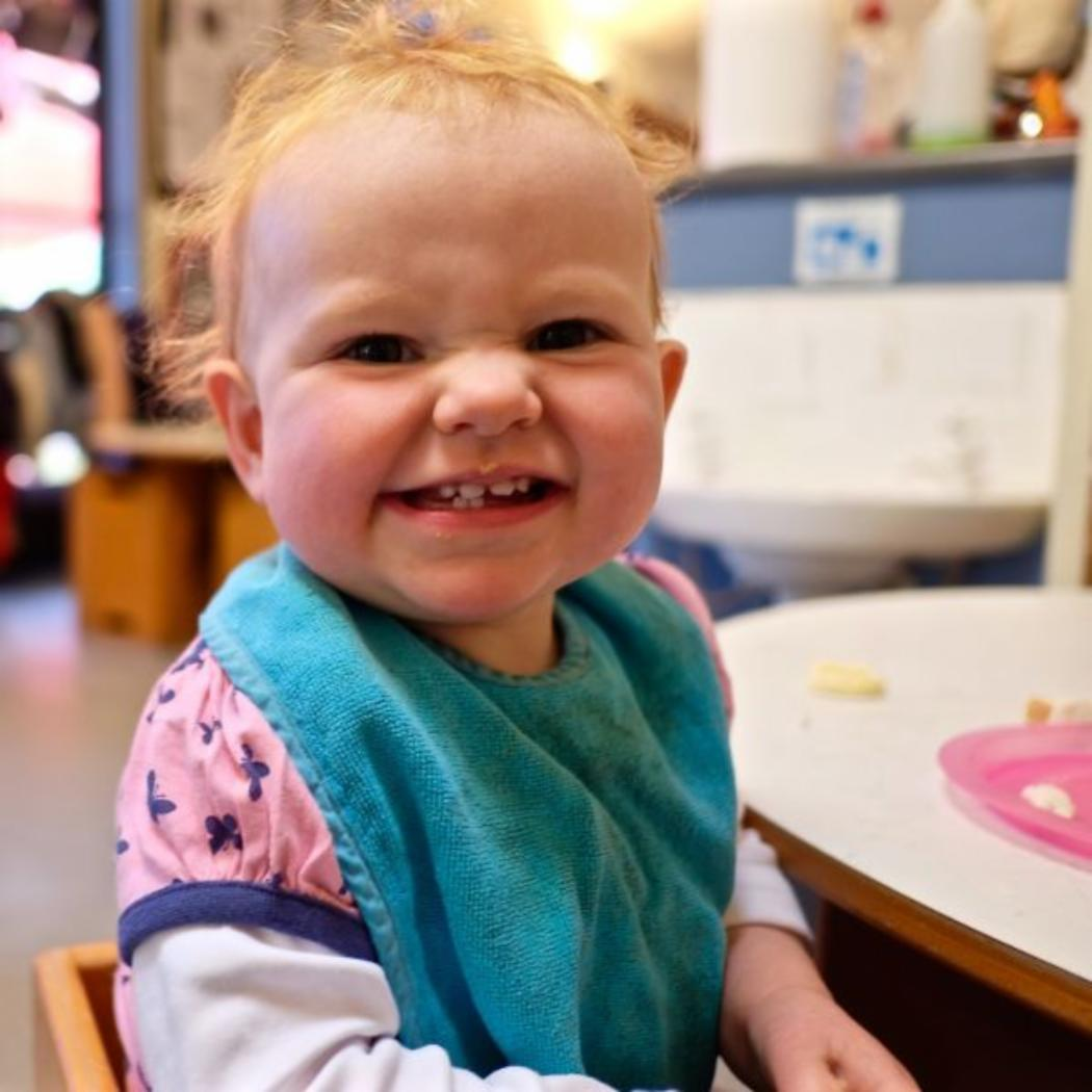 Childcare-centre-baby-smiling-lunchtime_EYC_gallery.jpg