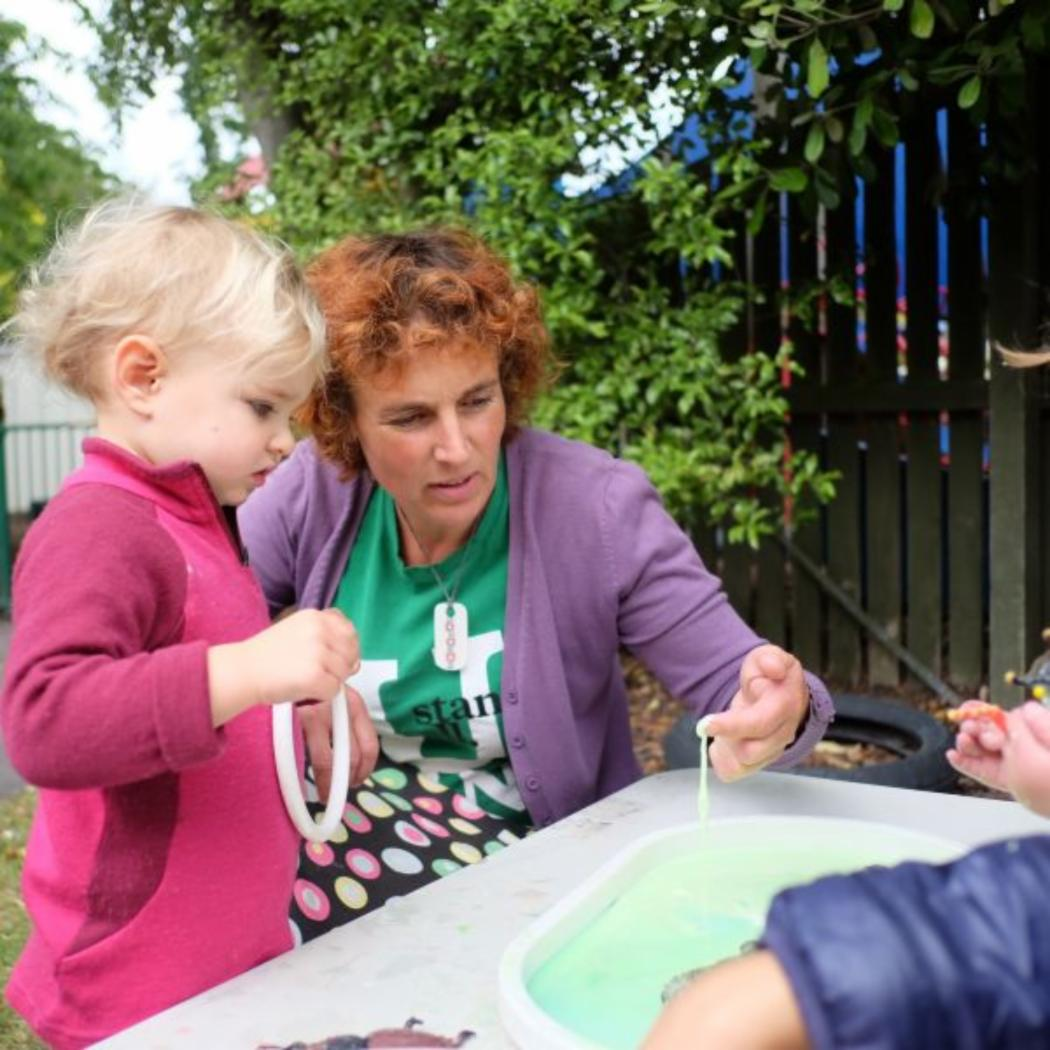 Childcare-centre-child-teacher-playing-with-slime_EYC_gallery.jpg