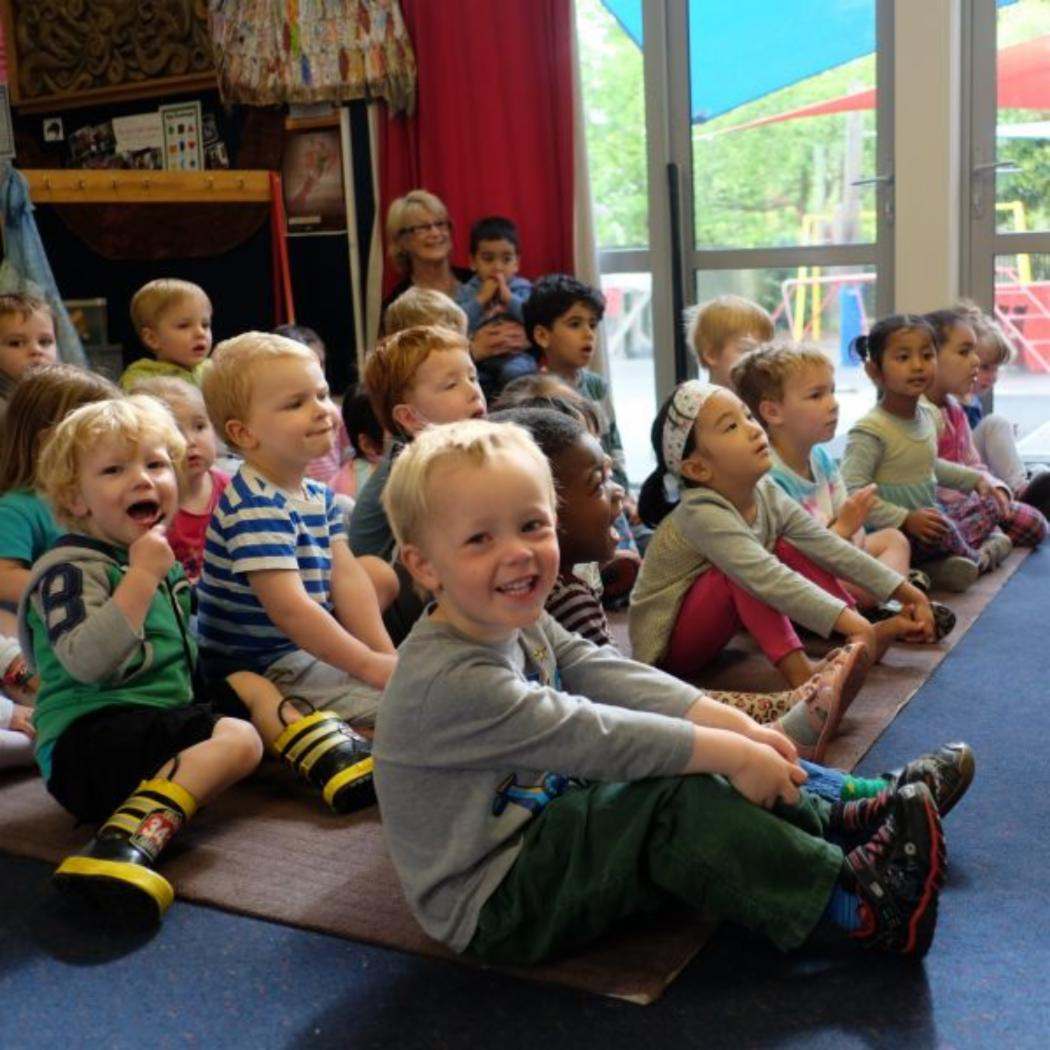 Childcare-centre-class-storytime-on-mat_EYC_gallery.jpg