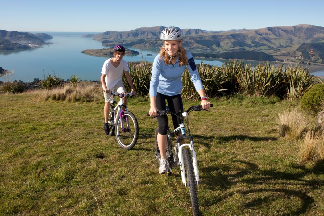 students riding bikes in port hills