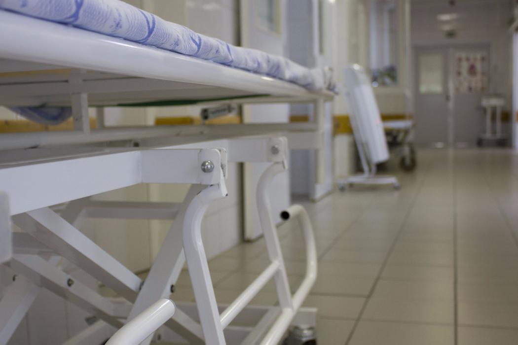 bed in hospital corridor