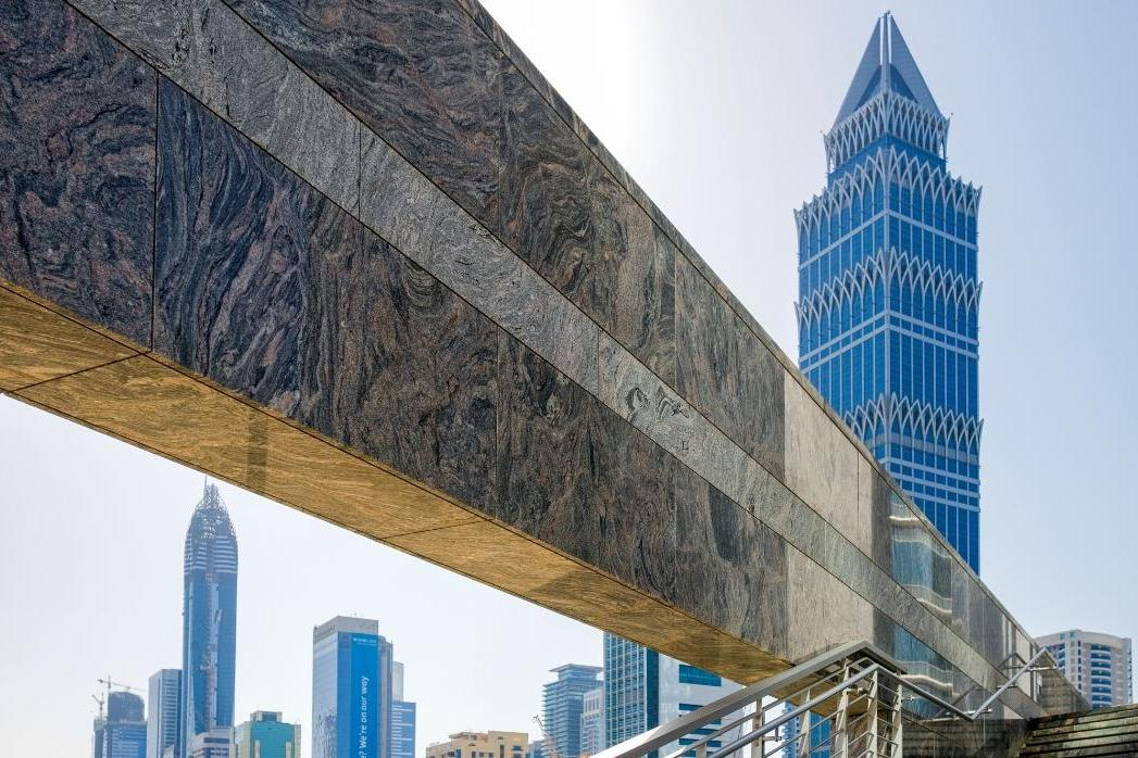 Dubai skyline with stone beam foreground