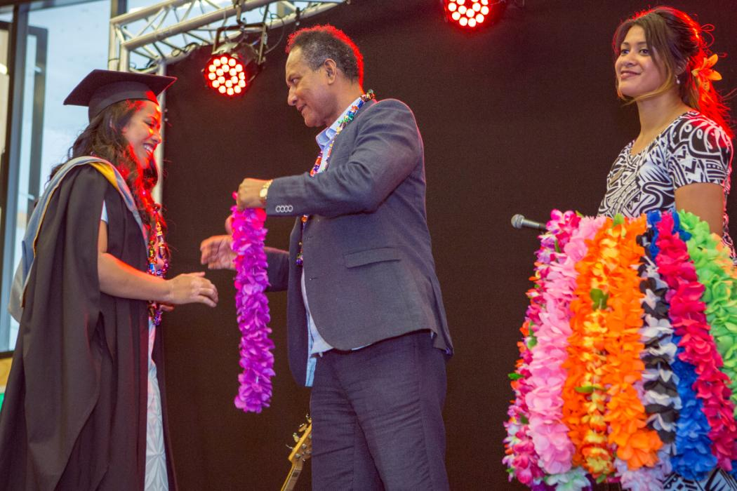 pacific student receives lei at graduation