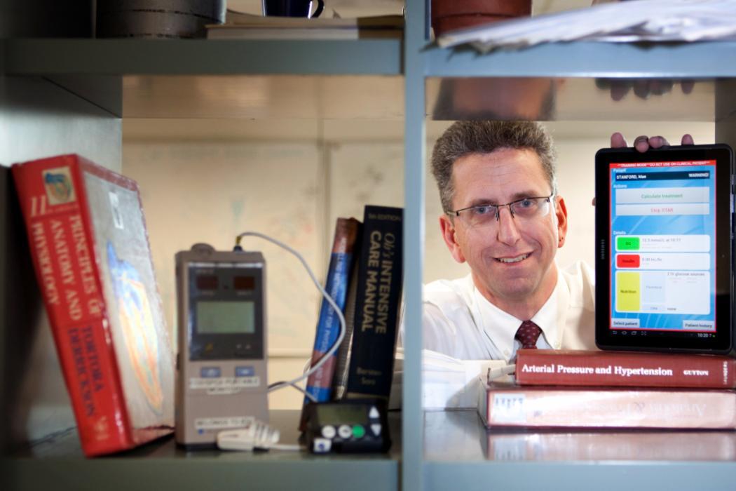 Professor Geoff Chase behind bookshelf