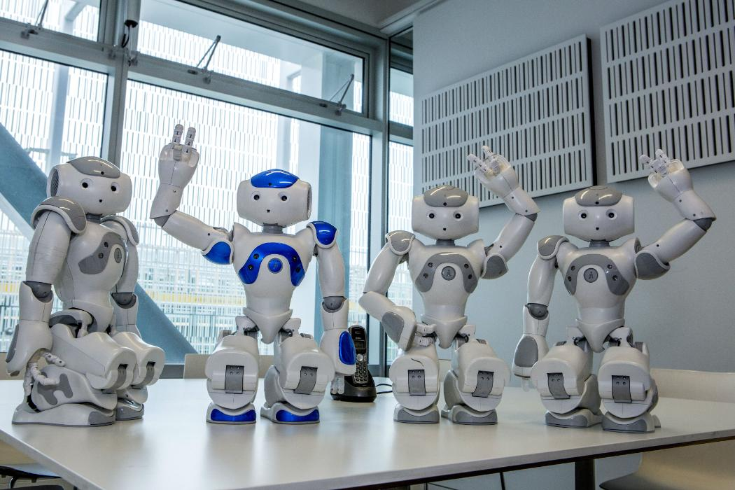 robots waving on a table