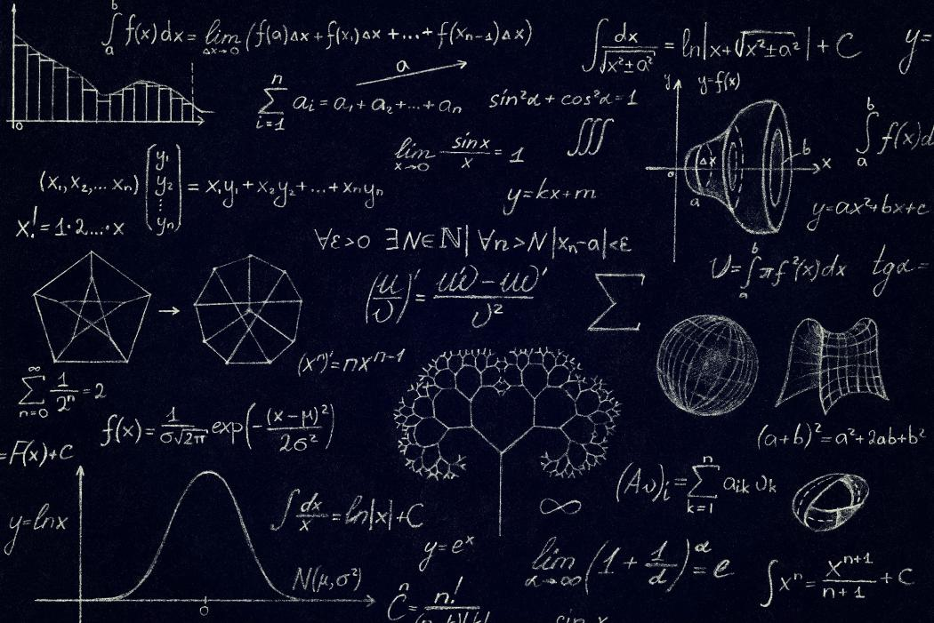maths equations and graphs on blackboard