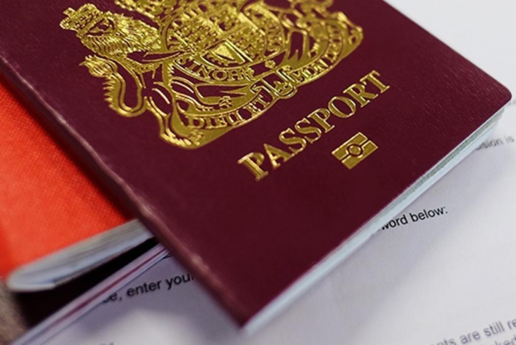 Pile of International passports for 3 column grid