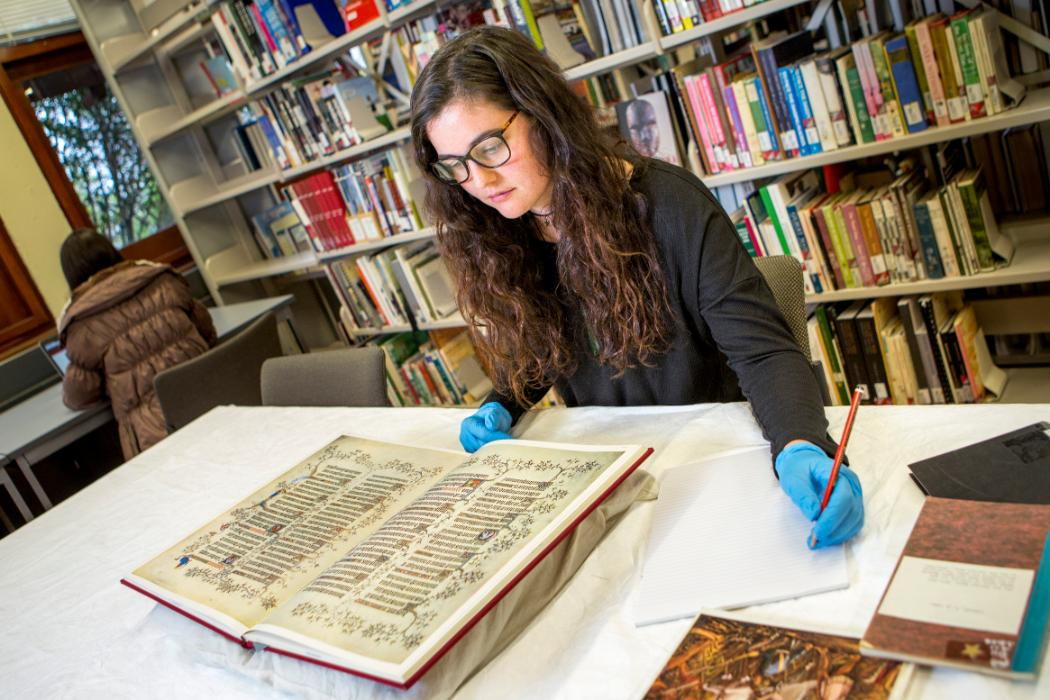 Student with special collection book