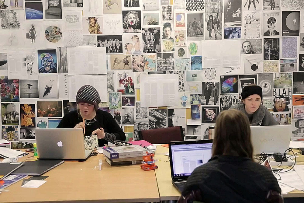 Arts students studying desk wall drawings landscape