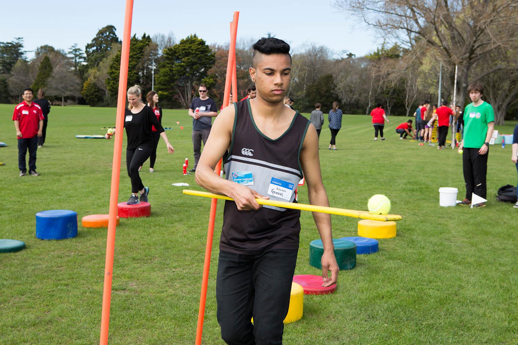 UC bound students balancing balls