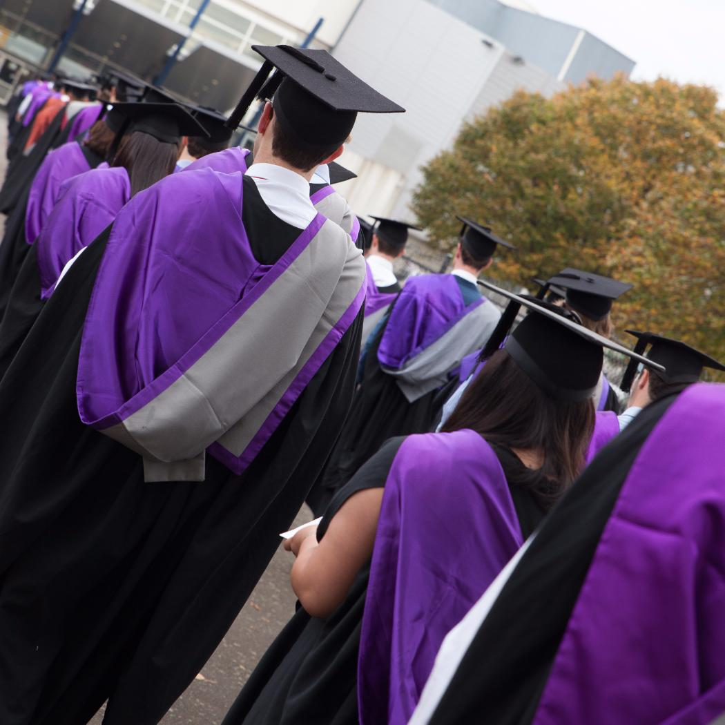engineering graduates march into arena