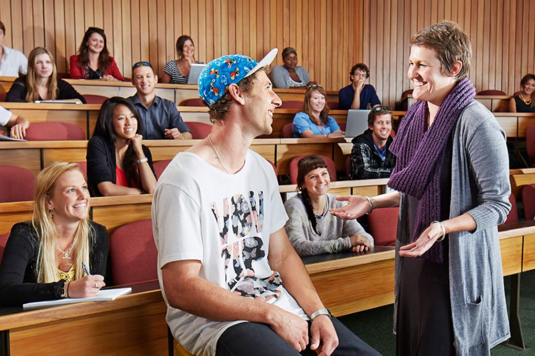 Law lecturer teaching students in lecture theatre landscape