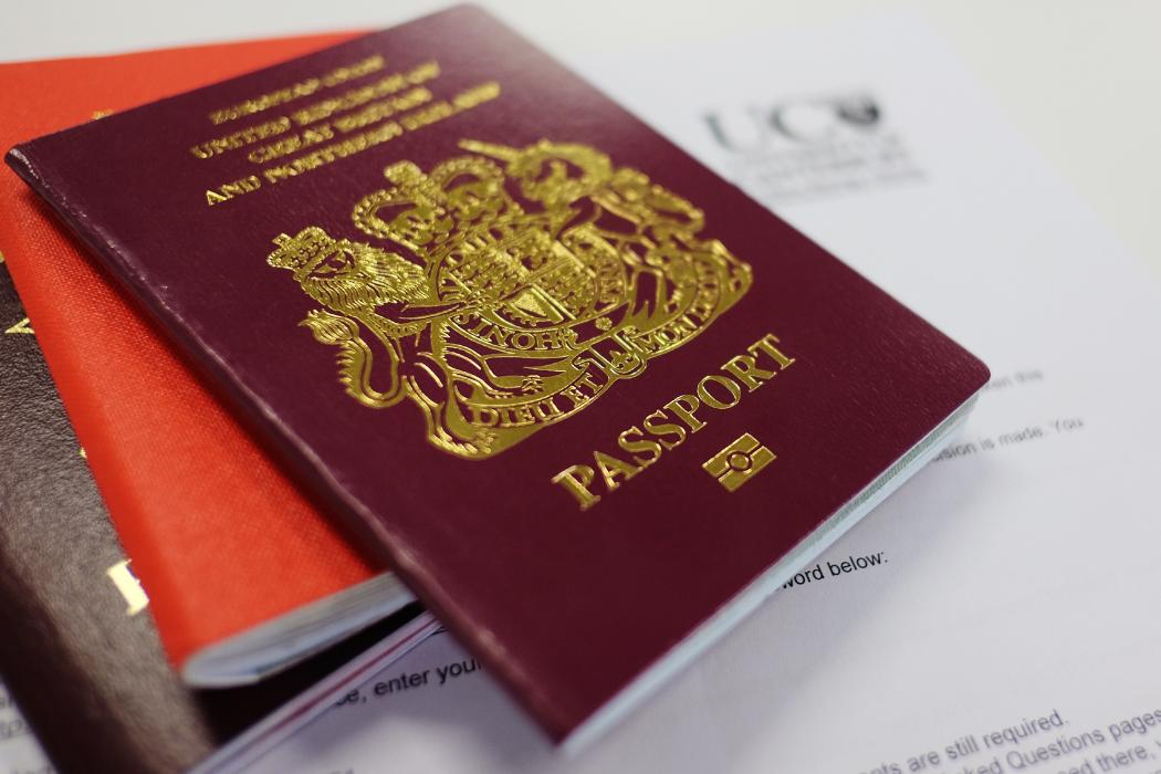 Pile of passports laid on the table